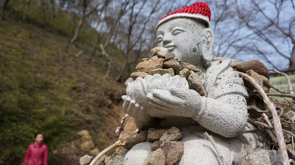 """Don't be fooled by the rocks that I got…"" (says this baby Buddha from a temple in Daewon)"