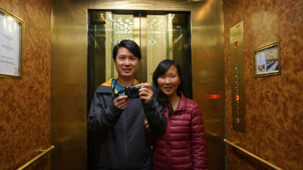 The smile on my wife's face may look fake, but she actually does love me. Taken in an elevator at Hotel Paris.